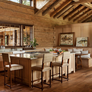 Rustic kitchen pictures - Example of a mountain style medium tone wood floor kitchen design in Other with a farmhouse sink, shaker cabinets, medium tone wood cabinets, wood backsplash and an island