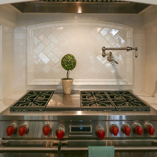 Eat-in kitchen - huge transitional u-shaped dark wood floor and brown floor eat-in kitchen idea in Charlotte with marble countertops, white backsplash, subway tile backsplash, stainless steel appliances, two islands, an undermount sink, beaded inset cabinets and white cabinets
