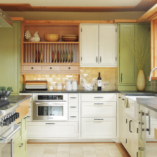 Design ideas for a contemporary kitchen in Burlington with stainless steel appliances, soapstone benchtops, green cabinets, a farmhouse sink, shaker cabinets and yellow splashback.
