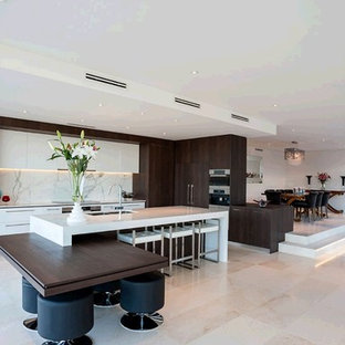 Design ideas for a large contemporary galley eat-in kitchen in Perth with a drop-in sink, louvered cabinets, dark wood cabinets, quartz benchtops, multi-coloured splashback, stone slab splashback, stainless steel appliances, limestone floors and multiple islands.