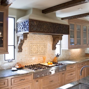 Mountain style kitchen photo in Los Angeles with stainless steel appliances, medium tone wood cabinets, granite countertops, beige backsplash and stone tile backsplash