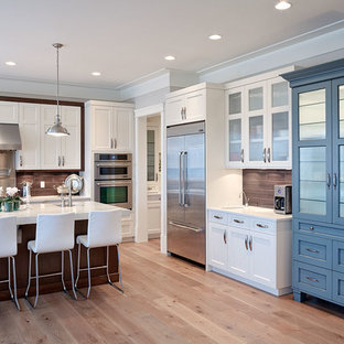 Eat-in kitchen - contemporary u-shaped eat-in kitchen idea in Vancouver with recessed-panel cabinets, white cabinets, brown backsplash, subway tile backsplash and an undermount sink
