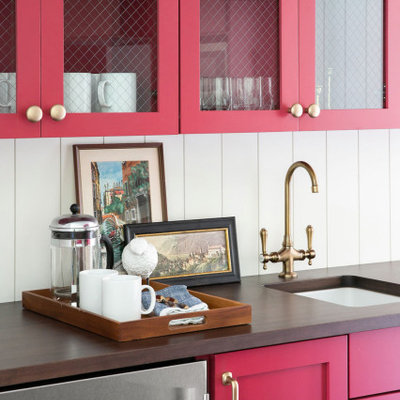 Example of a small beach style galley vinyl floor and brown floor kitchen design in Milwaukee with an undermount sink, glass-front cabinets, red cabinets, wood countertops, white backsplash, wood backsplash, stainless steel appliances and brown countertops