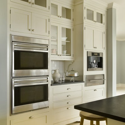 Example of a trendy kitchen design in Providence with shaker cabinets, stainless steel appliances, subway tile backsplash, white cabinets and white backsplash