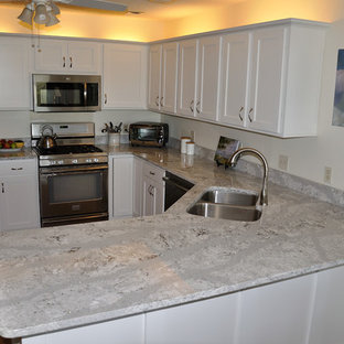 Mid-sized traditional eat-in kitchen appliance - Inspiration for a mid-sized timeless l-shaped eat-in kitchen remodel in Atlanta with an undermount sink, raised-panel cabinets, white cabinets, quartz countertops, stainless steel appliances and no island
