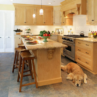 Inspiration for a mid-sized timeless l-shaped ceramic tile and brown floor eat-in kitchen remodel in New York with an undermount sink, recessed-panel cabinets, light wood cabinets, laminate countertops, stainless steel appliances, white backsplash, subway tile backsplash and an island