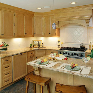 Example of a mid-sized classic l-shaped ceramic tile and brown floor eat-in kitchen design in New York with an undermount sink, recessed-panel cabinets, light wood cabinets, stainless steel appliances, laminate countertops, white backsplash, subway tile backsplash and an island