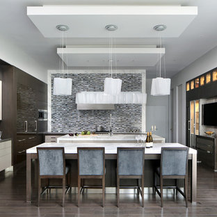 Expansive contemporary u-shaped kitchen in San Francisco with an undermount sink, flat-panel cabinets, grey splashback, mosaic tile splashback and multiple islands.