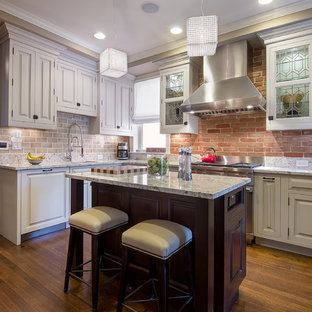 Traditional kitchen remodeling - Example of a classic kitchen design in Denver with stainless steel appliances and subway tile backsplash