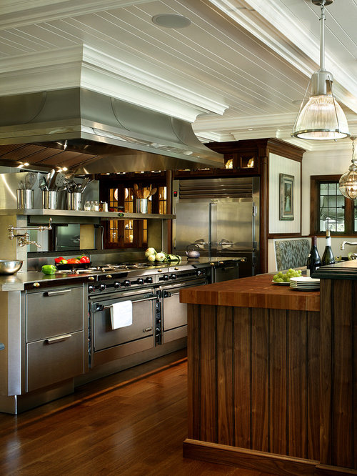 Example Of A Large Transitional Dark Wood Floor Eat In Kitchen Design In  New York