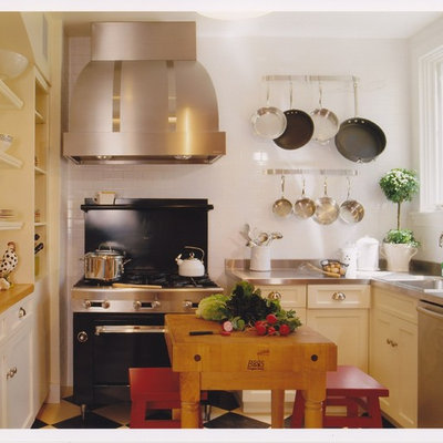 Enclosed kitchen - eclectic enclosed kitchen idea in San Francisco with a drop-in sink, open cabinets, white cabinets, stainless steel countertops, white backsplash, subway tile backsplash and black appliances