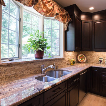Chefs view in this Tuscan kitchen, granite ledge on the bay window