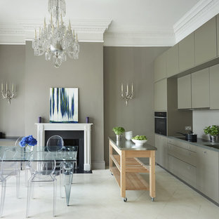 Inspiration for a contemporary single-wall kitchen/diner in London with flat-panel cabinets, grey cabinets and an island.