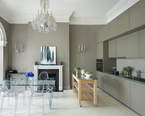 Trendy Single Wall Eat In Kitchen Photo In London With Flat Panel Cabinets