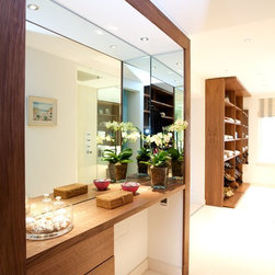 Chelsea Residence - Walk - in wardrobe in walnut with glass fronted drawers and pull-out trays
