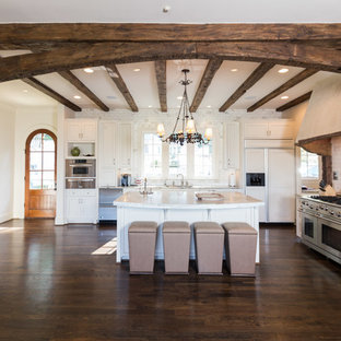 Example of a huge classic u-shaped dark wood floor eat-in kitchen design in Birmingham with white cabinets, granite countertops, gray backsplash, stainless steel appliances, an island, an undermount sink, recessed-panel cabinets and subway tile backsplash