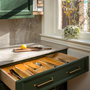 Small transitional l-shaped eat-in kitchen in Louisville with a single-bowl sink, recessed-panel cabinets, green cabinets, quartzite benchtops, grey splashback, stone slab splashback, stainless steel appliances, medium hardwood floors, a peninsula and grey benchtop.