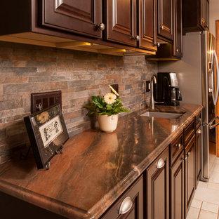 Cherry Cabinets, Copper Dune Quartzite counters, stacked stone backsplash, no gr