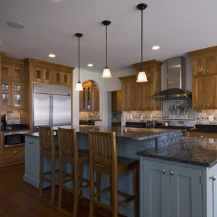 Traditional kitchen photos - Example of a classic l-shaped kitchen design in DC Metro with shaker cabinets, medium tone wood cabinets, granite countertops, stone tile backsplash and stainless steel appliances
