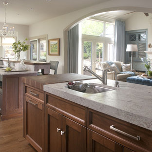 Transitional open concept kitchen ideas - Transitional open concept kitchen photo in Denver with an undermount sink, recessed-panel cabinets, dark wood cabinets and granite countertops
