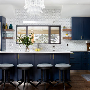 Transitional kitchen designs - Transitional l-shaped dark wood floor and brown floor kitchen photo in Denver with shaker cabinets, blue cabinets, white backsplash, stainless steel appliances, an island and white countertops