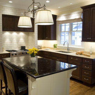 Traditional kitchen designs - Inspiration for a timeless kitchen remodel in Chicago with an undermount sink, recessed-panel cabinets, dark wood cabinets, granite countertops, white backsplash, subway tile backsplash and stainless steel appliances