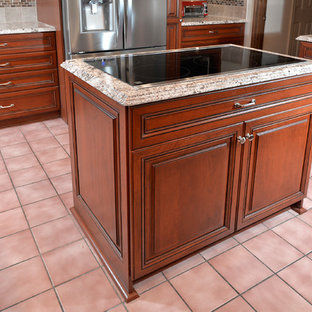 Inspiration for a mid-sized transitional u-shaped eat-in kitchen in DC Metro with an undermount sink, raised-panel cabinets, medium wood cabinets, granite benchtops, grey splashback, ceramic splashback, stainless steel appliances, ceramic floors, with island, pink floor and grey benchtop.