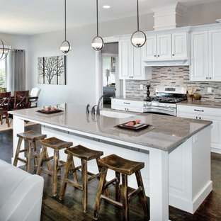 Large transitional eat-in kitchen designs - Inspiration for a large transitional single-wall dark wood floor eat-in kitchen remodel in Salt Lake City with an undermount sink, raised-panel cabinets, white cabinets, quartz countertops, multicolored backsplash, stone tile backsplash, stainless steel appliances and an island