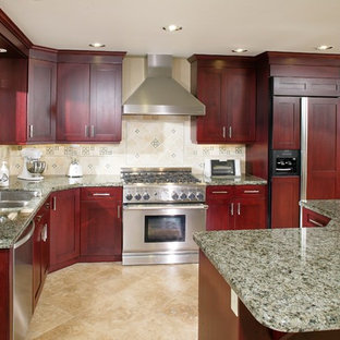 Large minimalist l-shaped travertine floor eat-in kitchen photo in Sacramento with a double-bowl sink, shaker cabinets, dark wood cabinets, granite countertops, beige backsplash, mosaic tile backsplash, paneled appliances and an island