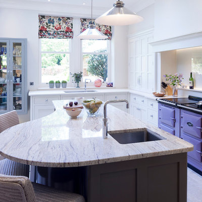 Example of a mid-sized transitional galley beige floor eat-in kitchen design in Cheshire with an undermount sink, shaker cabinets, white cabinets, colored appliances, an island and beige countertops