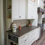 White Kitchen With Wood Island Carrara Backsplash Black