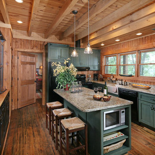 This is an example of a large traditional u-shaped eat-in kitchen in Atlanta with a farmhouse sink, recessed-panel cabinets, green cabinets, granite benchtops, brown splashback, black appliances and with island.