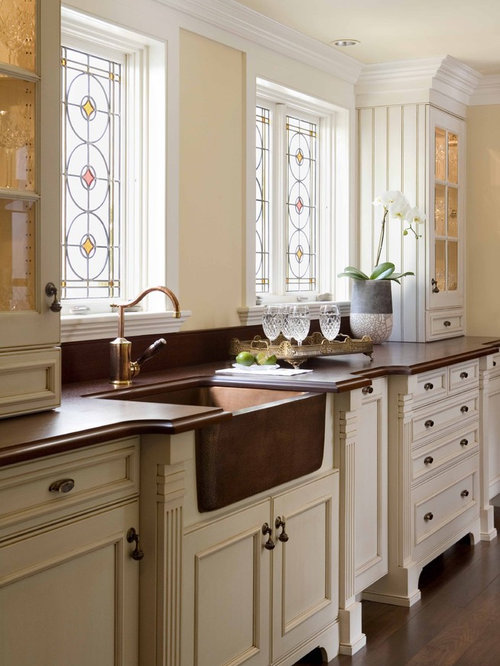 Example of a classic kitchen design in Boston with recessed-panel ...