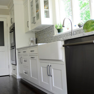 Transitional single-wall dark wood floor eat-in kitchen photo in New York with a farmhouse sink, shaker cabinets, gray cabinets, marble countertops, gray backsplash, cement tile backsplash, stainless steel appliances and an island