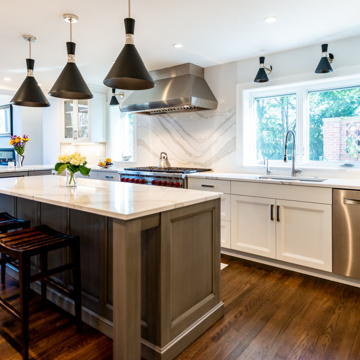 This remodeled and expanded Kitchen opens up and connects the space to the Dining Room.