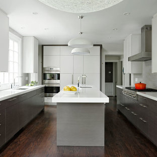Large midcentury galley eat-in kitchen in DC Metro with a drop-in sink, flat-panel cabinets, grey cabinets, quartz benchtops, white splashback, ceramic splashback, stainless steel appliances, dark hardwood floors, with island and brown floor.