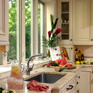 Design ideas for a medium sized classic u-shaped kitchen/diner in DC Metro with a submerged sink, beaded cabinets, white cabinets, granite worktops, an island, multi-coloured splashback, mosaic tiled splashback, stainless steel appliances, cement flooring and beige floors.