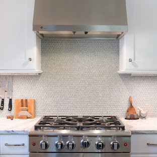 This is an example of a medium sized classic u-shaped kitchen/diner in Other with a submerged sink, shaker cabinets, white cabinets, granite worktops, grey splashback, mosaic tiled splashback, coloured appliances, medium hardwood flooring and an island.