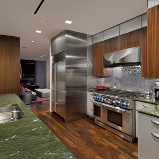 Design ideas for a mid-sized contemporary galley eat-in kitchen in Chicago with an undermount sink, flat-panel cabinets, medium wood cabinets, metallic splashback, stainless steel appliances, mosaic tile splashback, granite benchtops, dark hardwood floors, with island, brown floor and green benchtop.