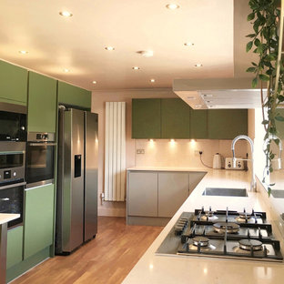 Inspiration for a mid-sized l-shaped eat-in kitchen in Essex with quartzite benchtops, pink splashback, vinyl floors, a peninsula, brown floor and pink benchtop.