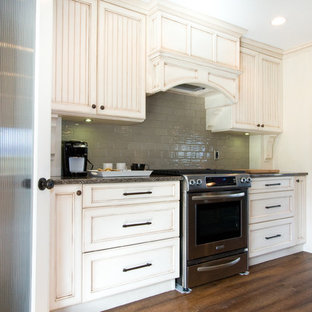 Inspiration for a large timeless galley open concept kitchen remodel in Vancouver with an undermount sink, beige cabinets, quartz countertops, green backsplash, stainless steel appliances and an island