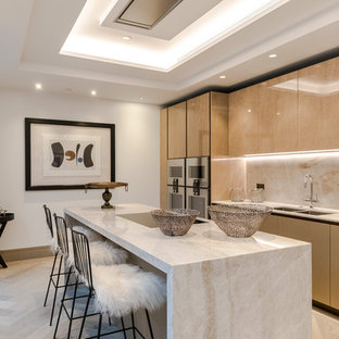 Inspiration for a contemporary single-wall enclosed kitchen in London with a double-bowl sink, flat-panel cabinets, beige cabinets, beige splashback, black appliances, light hardwood flooring, an island, beige floors and beige worktops.