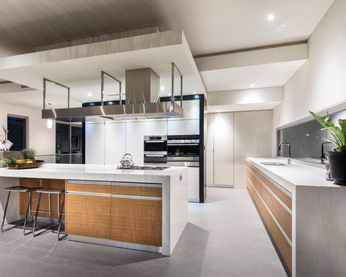 Trendy L Shaped Kitchen Photo In Perth With Flat Panel Cabinets, Medium Tone