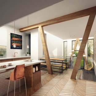 Inspiration for a scandinavian kitchen in Manchester with flat-panel cabinets, light wood cabinets, limestone benchtops and light hardwood floors.