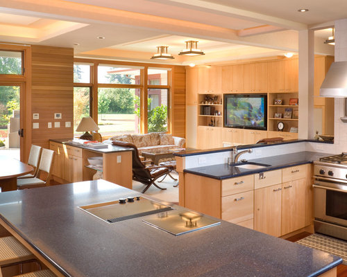 Inspiration for a contemporary open concept kitchen remodel in Portland  with flat-panel cabinets,