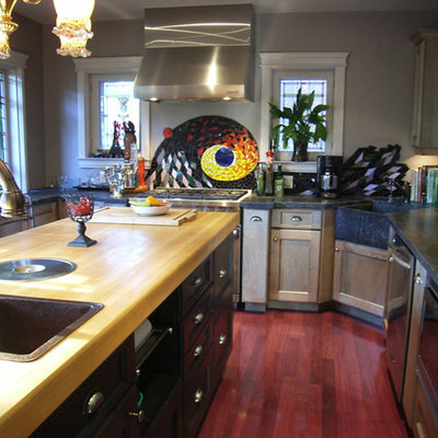 Kitchen pantry - large eclectic u-shaped medium tone wood floor kitchen pantry idea in Toronto with a farmhouse sink, shaker cabinets, medium tone wood cabinets, soapstone countertops, multicolored backsplash, mosaic tile backsplash, stainless steel appliances and an island