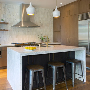 Contemporary kitchen appliance - Trendy dark wood floor kitchen photo in San Francisco with an undermount sink, flat-panel cabinets, medium tone wood cabinets, multicolored backsplash, stainless steel appliances and an island