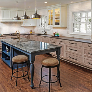 Traditional kitchen designs - Kitchen - traditional l-shaped dark wood floor and brown floor kitchen idea in Milwaukee with an undermount sink, recessed-panel cabinets, medium tone wood cabinets, white backsplash, subway tile backsplash, an island and brown countertops