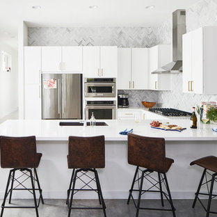 Contemporary kitchen ideas - Example of a trendy u-shaped concrete floor and gray floor kitchen design in Austin with an undermount sink, flat-panel cabinets, white cabinets, multicolored backsplash and stainless steel appliances