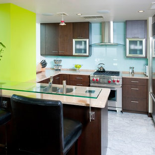 Photo of a small contemporary u-shaped eat-in kitchen in Other with an undermount sink, flat-panel cabinets, medium wood cabinets, blue splashback, stainless steel appliances, marble floors, a peninsula, recycled glass benchtops and glass sheet splashback.